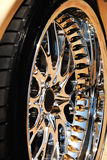 Golden wheel of the car and tyre. Closeup of the golden wheel and tyre cover stock photo