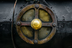 Golden wheel. Metal wheel on train in a train museum Stock Images