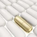 Golden and white medicine pill capsule background Royalty Free Stock Photo