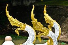 Golden-white Naga sculpture on pond in Vientiane, Laos. Golden-white Naga sculpture on pond in Vientiane Stock Photos