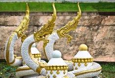 Golden-white Naga sculpture on pond in Vientiane, Laos. Golden-white Naga sculpture on pond in Vientiane Stock Photo