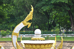 Golden-white Naga sculpture on pond in Vientiane, Laos. Golden-white Naga sculpture on pond in Vientiane Royalty Free Stock Image