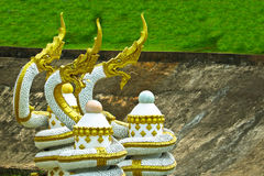 Golden-white Naga sculpture on pond in Vientiane, Laos. Golden-white Naga sculpture on pond in Vientiane Royalty Free Stock Photos