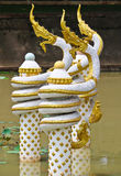 Golden-white Naga sculpture on pond in Vientiane, Laos. Golden-white Naga sculpture on pond in Vientiane Royalty Free Stock Images