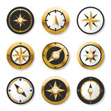 Golden wind rose golden compasses in set. Stock Photo