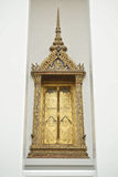 Golden window Wat Suthat Thep Wararam. Golden window of the Temple, which is located on Wat Suthat Thep Wararam Stock Image