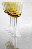 Golden Wine Glasses. Five golden wine glasses in a row stock images