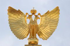 Golden Wings. Golden Eagle on Clear Sky, Symbol of Monarchy stock photography