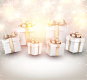 Golden winter background with christmas gifts. Royalty Free Stock Images