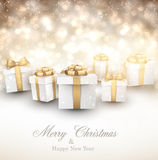 Golden winter background with christmas gifts. Royalty Free Stock Photos