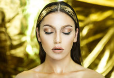Golden woman art mua. Golden woman Taurus, art. Christmas New Year. Photo with big free space, area place for text, inscription or buttons (if you use this photo royalty free stock photo