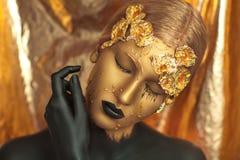Golden woman Royalty Free Stock Photos