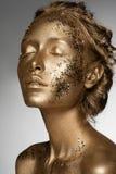 Golden woman Stock Photos