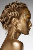 Golden woman stock photo