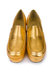 Golden woman shoes isolated Stock Photos