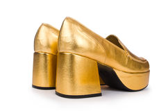 Golden woman shoes isolated Royalty Free Stock Photography