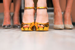 Golden woman shoes Royalty Free Stock Image