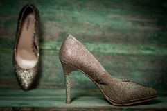 Golden women shoes on wooden background Royalty Free Stock Photo
