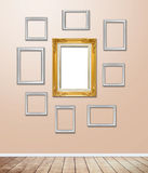 Golden wood Frame decor on wallpaper with light flare. Royalty Free Stock Images