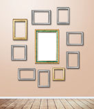 Golden wood Frame decor on wallpaper with light flare. Royalty Free Stock Image