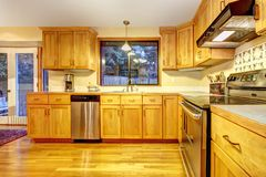 Golden wood kitchen with hardwood floor. Royalty Free Stock Photo