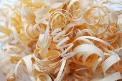 Golden wood shavings Stock Images