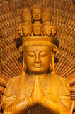 Golden Wood Statue of Guan Yin with 1000 hands Stock Images