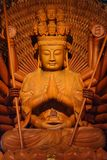 Golden Wood Statue of Guan Yin Stock Images