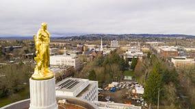 The Golden Woodcutter Oregon Pioneer atop Capital Building Salem stock photos