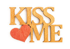 Golden words. Kiss me isolated on the white background Stock Photo