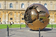 Golden world ball in Vatican with green grass. Rome, Italy. Royalty Free Stock Photos