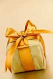 Golden wrapped gift box Royalty Free Stock Image
