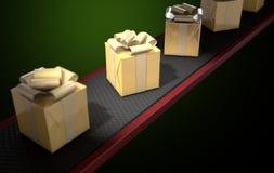 Golden Wrapped Gift Box On Conveyor Royalty Free Stock Photos