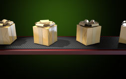 Golden Wrapped Gift Box On Conveyor Stock Photography