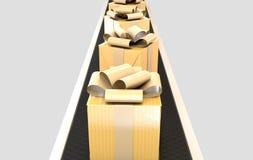 Golden Wrapped Gift Box On Conveyor Stock Photos