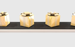 Golden Wrapped Gift Box On Conveyor Stock Images