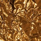 Golden wrinkled foil texture for background Stock Image