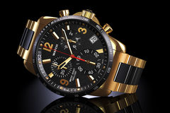Golden wrist watch Stock Photos