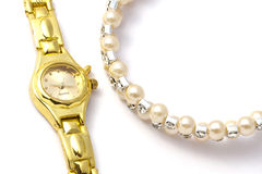 Golden wrist watch and necklace Royalty Free Stock Images