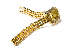 Golden wristwatch with gems Stock Photos