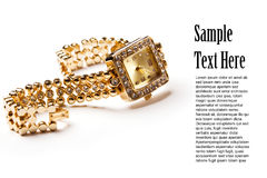 Golden wristwatch with gems Royalty Free Stock Photo