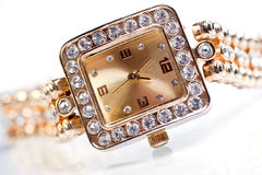 Golden wristwatch with gems Stock Photo