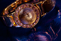 Golden wristwatch with gems Royalty Free Stock Photos