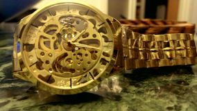 The golden wristwatch stock video
