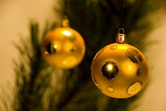 Golden Xmas baubles Stock Image