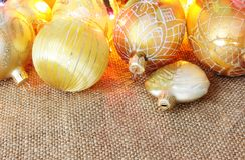 Golden xmas toys on burlap Stock Image