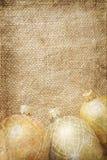 Golden xmas toys on burlap Royalty Free Stock Images