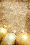 Golden xmas toys on burlap Stock Photography