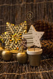 A Golden Xmass decorations. A Christmass image with a wooden star and golden apples Royalty Free Stock Image