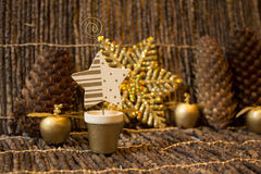 A Golden Xmass decorations. A Christmass image with a wooden star and golden apples Stock Images